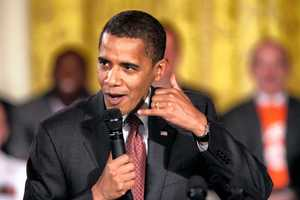 AP: Obama urges involvement by fathers