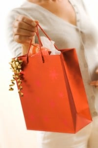 Woman holding a gift's bag