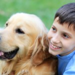 Smiling child and his cute dog.